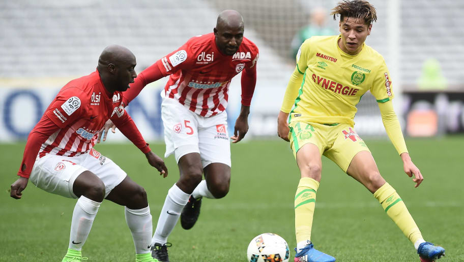 Nantes' French midfielder Amine Harit (R) vies with Nancy's French midfielder Issiar Dia (L) and Nancy's French defender Modou Diagne during the French L1 football match between Nantes and Nancy on February 5, 2017 at Beaujoire Stadium in Nantes, western France. / AFP / JEAN-SEBASTIEN EVRARD        (Photo credit should read JEAN-SEBASTIEN EVRARD/AFP/Getty Images)