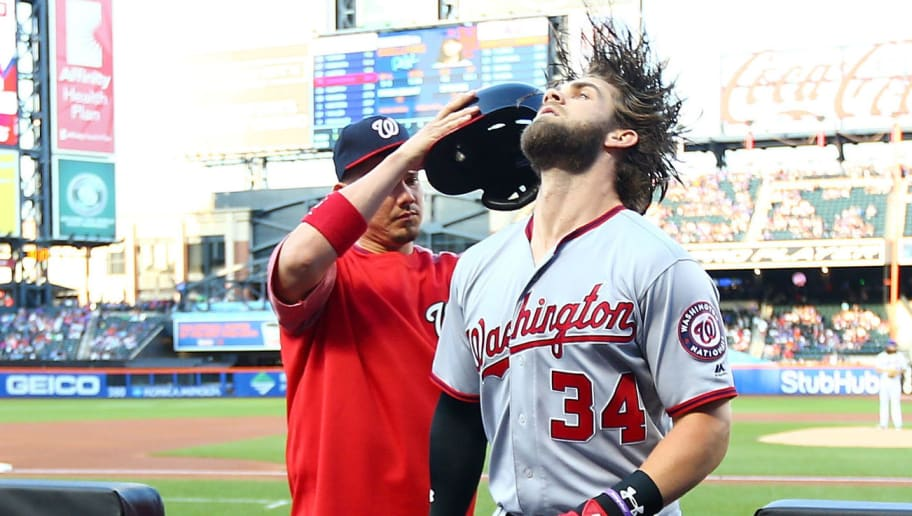NEW YORK, NEW YORK - JUNE 15: Bryce Harper #34 of the Washington Nationals is congratulated after hitting a first inning solo home run against the New York Mets at Citi Field on June 15, 2017 in the Flushing neighborhood of the Queens borough of New York City.  (Photo by Mike Stobe/Getty Images)