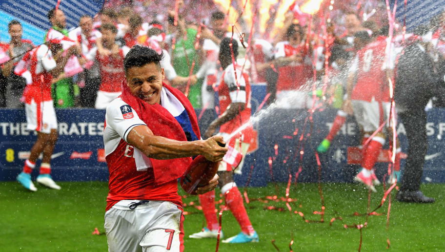 LONDON, ENGLAND - MAY 27:  Alexis Sanchez of Arsenal celebrates after The Emirates FA Cup Final between Arsenal and Chelsea at Wembley Stadium on May 27, 2017 in London, England.  (Photo by Laurence Griffiths/Getty Images)