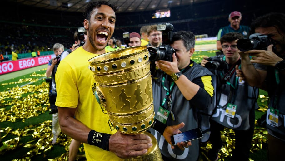 BERLIN, GERMANY - MAY 27:  Pierre-Emerick Aubameyang of Dortmund celebrates with the trophy after winning the DFB Cup Final 2017 between Eintracht Frankfurt and Borussia Dortmund at Olympiastadion on May 27, 2017 in Berlin, Germany.  (Photo by Matthias Hangst/Bongarts/Getty Images)