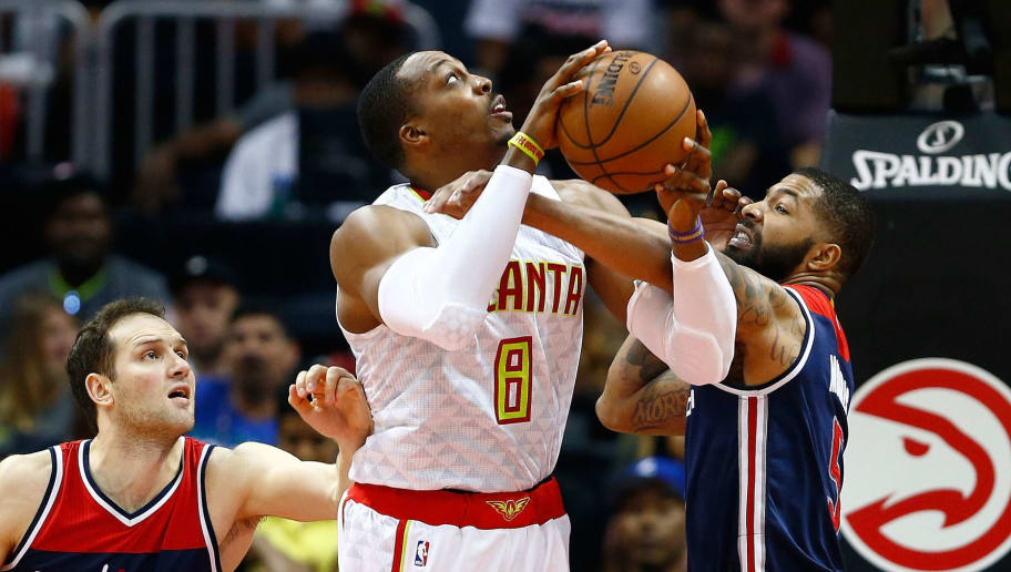 ATLANTA, GA - APRIL 22: Dwight Howard #8 of the Atlanta Hawks is fouled by Markieff Morris #5 of the Washington Wizards during the fourth quarter in Game Three of the Eastern Conference Quarterfinals during the 2017 NBA Playoffs at Philips Arena on April 22, 2017 in Atlanta, Georgia. NOTE TO USER: User expressly acknowledges and agrees that, by downloading and or using the photograph, User is consenting to the terms and conditions of the Getty Images License Agreement. (Photo by Daniel Shirey/Getty Images)