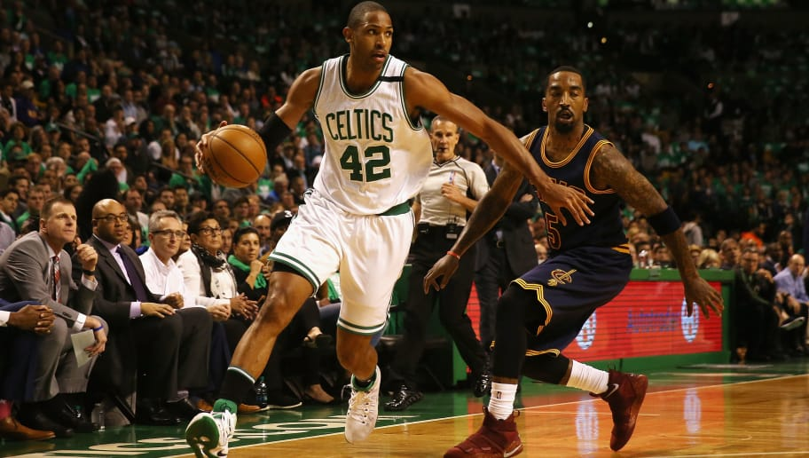BOSTON, MA - MAY 25:  Al Horford #42 of the Boston Celtics dribbles against JR Smith #5 of the Cleveland Cavaliers in the first half during Game Five of the 2017 NBA Eastern Conference Finals at TD Garden on May 25, 2017 in Boston, Massachusetts. NOTE TO USER: User expressly acknowledges and agrees that, by downloading and or using this photograph, User is consenting to the terms and conditions of the Getty Images License Agreement.  (Photo by Elsa/Getty Images)
