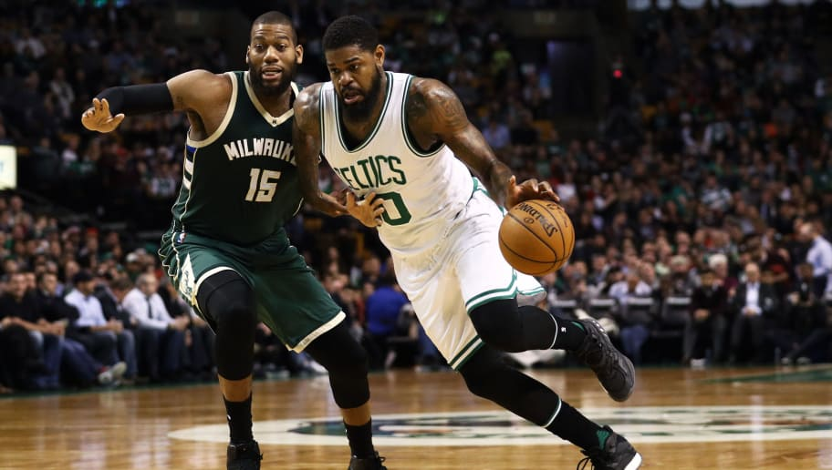 BOSTON, MA - MARCH 29: Greg Monroe #15 of the Milwaukee Bucks defends Amir Johnson #90 of the Boston Celtics during the third quarter at TD Garden on March 29, 2017 in Boston, Massachusetts. NOTE TO USER: User expressly acknowledges and agrees that by downloading and or using this photograph, User is consenting to the terms and conditions of the Getty Images License Agreement. (Photo by Maddie Meyer/Getty Images)