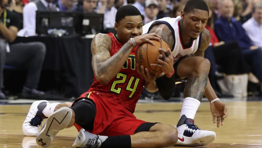 WASHINGTON, DC - APRIL 26: Kent Bazemore #24 of the Atlanta Hawks and Bradley Beal #3 of the Washington Wizards go after a loose ball in the first half in Game Five of the Eastern Conference Quarterfinals during the 2017 NBA Playoffs at at Verizon Center on April 26, 2017 in Washington, DC.  NOTE TO USER: User expressly acknowledges and agrees that, by downloading and or using this photograph, User is consenting to the terms and conditions of the Getty Images License Agreement.  (Photo by Rob Carr/Getty Images)