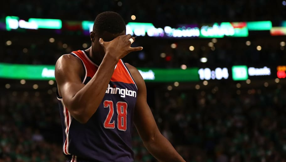 BOSTON, MA - MAY 15:  Ian Mahinmi #28 of the Washington Wizards reacts against the Boston Celtics during Game Seven of the NBA Eastern Conference Semi-Finals at TD Garden on May 15, 2017 in Boston, Massachusetts.  NOTE TO USER: User expressly acknowledges and agrees that, by downloading and or using this photograph, User is consenting to the terms and conditions of the Getty Images License Agreement.  (Photo by Elsa/Getty Images)