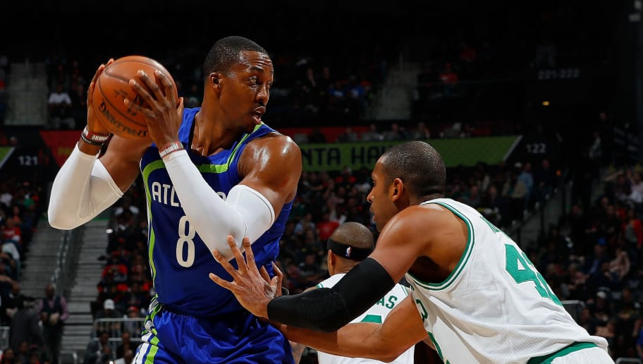 ATLANTA, GA - JANUARY 13:  Dwight Howard #8 of the Atlanta Hawks looks to drive against Al Horford #42 of the Boston Celtics at Philips Arena on January 13, 2017 in Atlanta, Georgia.  NOTE TO USER User expressly acknowledges and agrees that, by downloading and or using this photograph, user is consenting to the terms and conditions of the Getty Images License Agreement.  (Photo by Kevin C. Cox/Getty Images)
