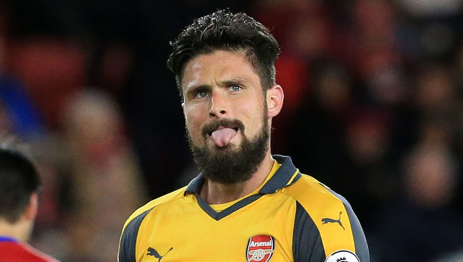 Arsenal's French striker Olivier Giroud reacts after failing to score during the English Premier League football match between Middlesbrough and Arsenal at Riverside Stadium in Middlesbrough, northeast England on April 17, 2017. / AFP PHOTO / Lindsey PARNABY / RESTRICTED TO EDITORIAL USE. No use with unauthorized audio, video, data, fixture lists, club/league logos or 'live' services. Online in-match use limited to 75 images, no video emulation. No use in betting, games or single club/league/player publications.  /         (Photo credit should read LINDSEY PARNABY/AFP/Getty Images)