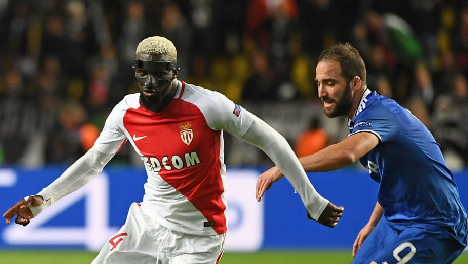 Juventus' Argentinian forward Gonzalo Higuain (R) and Monaco's midfielder Tiemoue Bakayoko (L) vie for the ball during the UEFA Champions League semi-final first leg football match Monaco vs Juventus at the Stade Louis II stadium in Monaco on May 3, 2017.  / AFP PHOTO / BORIS HORVAT        (Photo credit should read BORIS HORVAT/AFP/Getty Images)
