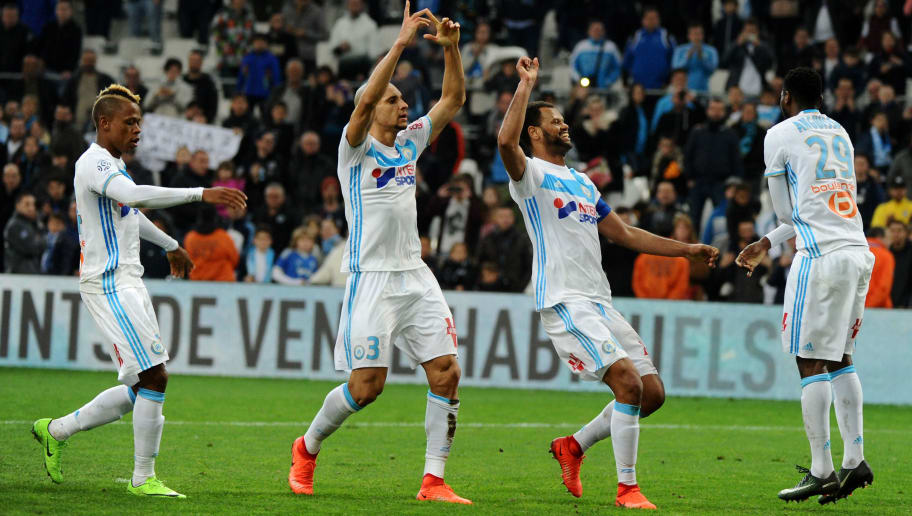 (From L) Marseille's Cameroonese forward Clinton Njie, Brazilian defender Doria, Portuguese defender Rolando and Cameroonese midfielder Andre-Frank Zambo Anguissa celebrate their win over Rennes after the French L1 football match Marseille vs Rennes on February 18, 2017, at the Velodrome stadium in Marseille, southern France.  / AFP / Franck PENNANT        (Photo credit should read FRANCK PENNANT/AFP/Getty Images)