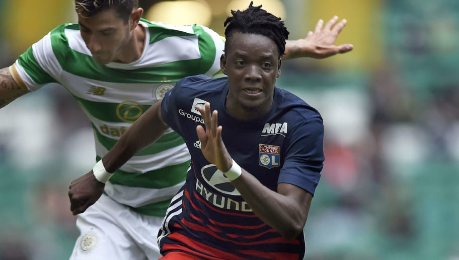Lyon's Burkina Faso midfielder Bertrand Traore chases the ball during the pre-season friendly football match between Glasgow Celtic and Olympique Lyonnais at Celtic Park in Glasgow, Scotland on July 15, 2017. / AFP PHOTO / Andy Buchanan        (Photo credit should read ANDY BUCHANAN/AFP/Getty Images)