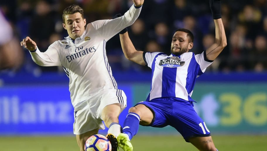 Real Madrid's Croatian midfielder Mateo Kovacic (L) vies with Deportivo La Coruna's Romanian forward Florin Andone during the Spanish league football match RC Deportivo vs Real Madrid CF at the Municipal de Riazor stadium in La Coruna on April 26, 2017. / AFP PHOTO / MIGUEL RIOPA        (Photo credit should read MIGUEL RIOPA/AFP/Getty Images)