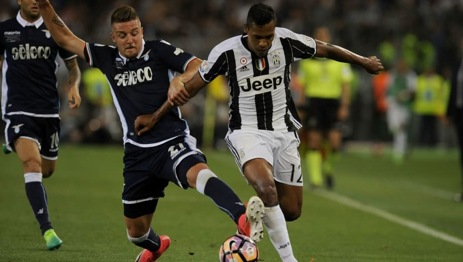 ROME, ROMA - MAY 17:  Alex Sandro of FC Juventus compete for the ball with Sergej Milinkovic Savic of SS Lazio during the TIM Cup Final match between SS Lazio and Juventus FC at Olimpico Stadium on May 17, 2017 in Rome, Italy.  (Photo by Marco Rosi/Getty Images)