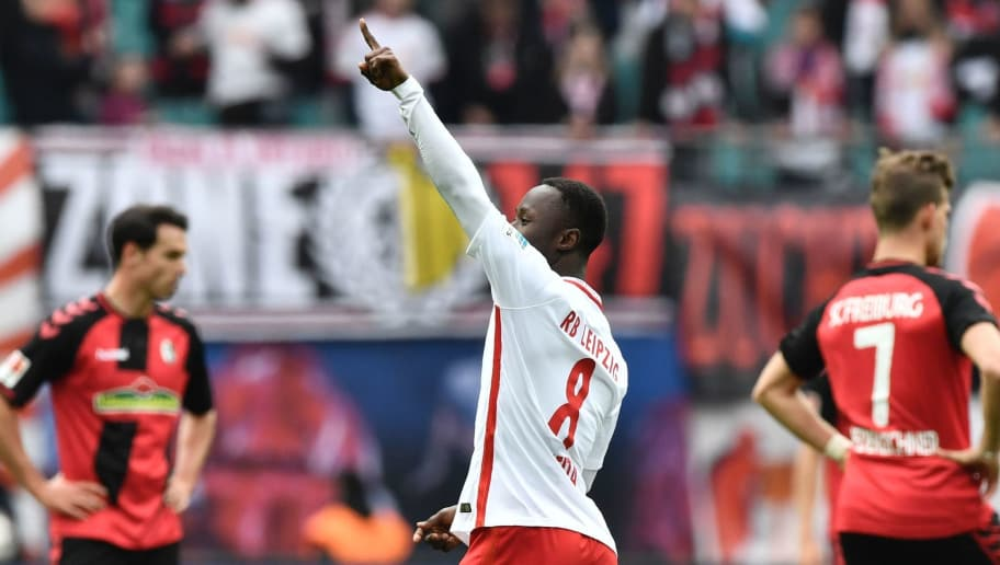 Leipzig's Guinean midfielder Naby Keita celebrates after scoring the third goal during the Bundesliga match RB Leipzig vs SC Freiburg in Leipzig on April 15, 2017.  Leipzig won 4 to 0, earning themselves a spot in next season's champions league. / AFP PHOTO / John MACDOUGALL / RESTRICTIONS: DURING MATCH TIME: DFL RULES TO LIMIT THE ONLINE USAGE TO 15 PICTURES PER MATCH AND FORBID IMAGE SEQUENCES TO SIMULATE VIDEO. == RESTRICTED TO EDITORIAL USE == FOR FURTHER QUERIES PLEASE CONTACT DFL DIRECTLY AT + 49 69 650050         (Photo credit should read JOHN MACDOUGALL/AFP/Getty Images)