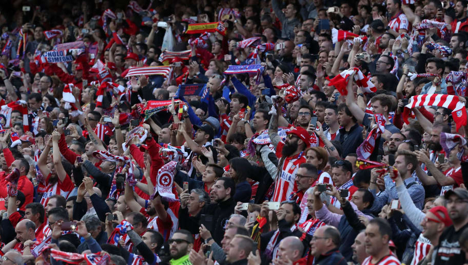 Atletico fans cheer their team during the UEFA Champions League semifinal second leg football match Club Atletico de Madrid vs Real Madrid CF at the Vicente Calderon stadium in Madrid, on May 10, 2017. / AFP PHOTO / CESAR MANSO        (Photo credit should read CESAR MANSO/AFP/Getty Images)