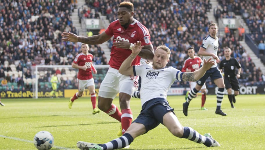 PRESTON, ENGLAND- APRIL 1:   Tom Clarke of Preston North End tackles Britt Assombalonga of Nottingham Forest during the Sky Bet Championship match between Preston North End and Nottingham Forest at Deepdale on April 1, 2017 in Preston, England. (Photo by Nathan Stirk/Getty Images)