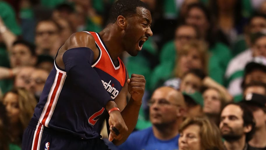 BOSTON, MA - MAY 15:  John Wall #2 of the Washington Wizards reacts against the Boston Celtics during Game Seven of the NBA Eastern Conference Semi-Finals at TD Garden on May 15, 2017 in Boston, Massachusetts.  NOTE TO USER: User expressly acknowledges and agrees that, by downloading and or using this photograph, User is consenting to the terms and conditions of the Getty Images License Agreement.  (Photo by Elsa/Getty Images)