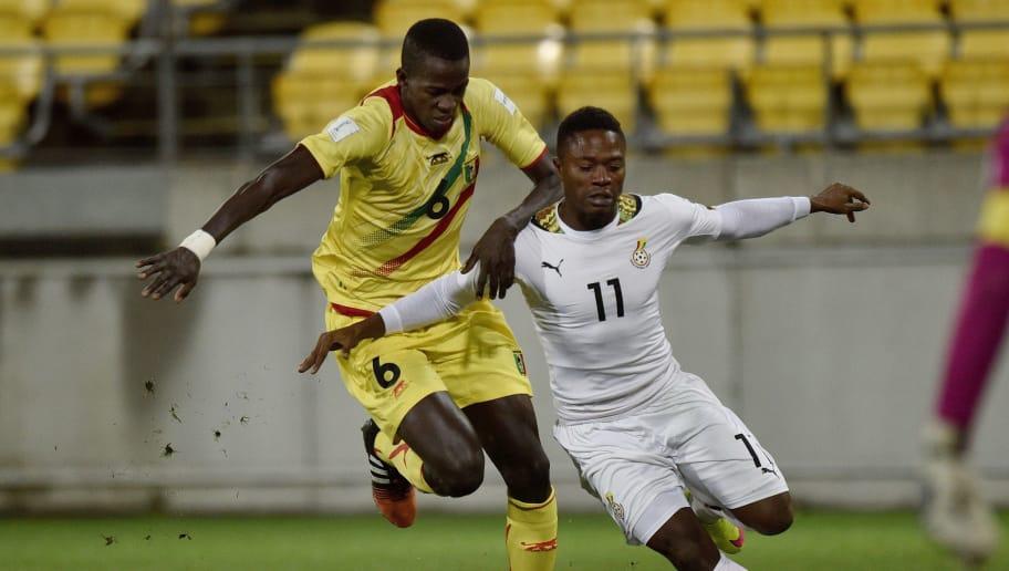Hamidou Maiga (L) of Mali tackles Abraham Attobrah of Ghana during their FIFA Under-20 World Cup round of 16 football match at Wellington Regional Stadium in Wellington on June 10, 2015. AFP PHOTO / MARTY MELVILLE        (Photo credit should read Marty Melville/AFP/Getty Images)