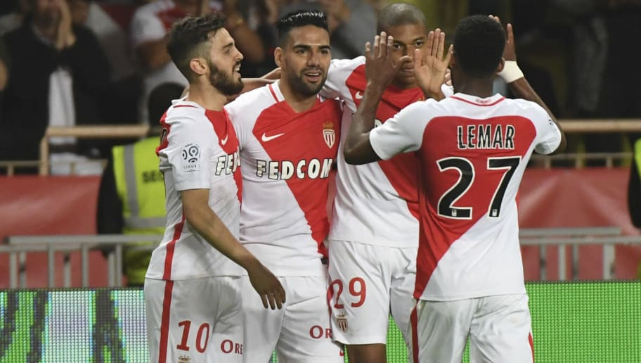 Monaco's Colombian forward Radamel Falcao (2ndL) celebrates with Monaco's Kylian Mbappe Lottin after scoring a goal during the French L1 football match between Monaco (ASM) and Lille (LOSC) at the Louis II Stadium in Monaco on May 14,2017. / AFP PHOTO / Yann COATSALIOU        (Photo credit should read YANN COATSALIOU/AFP/Getty Images)