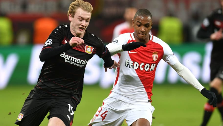 Leverkusen's midfielder Julian Brandt (L) and Monaco's Abdou Diallo vie for the ball during the UEFA Champions League group E football match between Bayer 04 Leverkusen and AS Monaco FC in Leverkusen, western Germany, on December 7, 2016. / AFP / PATRIK STOLLARZ        (Photo credit should read PATRIK STOLLARZ/AFP/Getty Images)