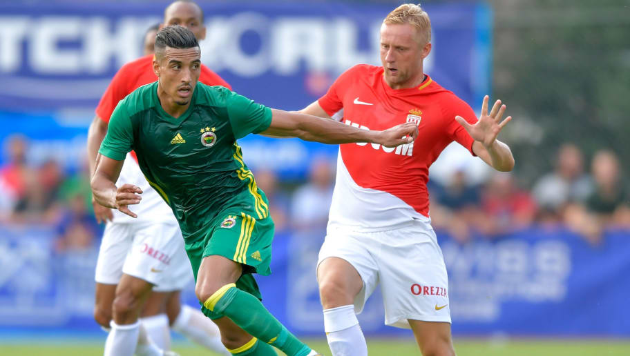 Fenerbahce's Moroccan-Belgiqn midfielder Nabil Dirar (L) outruns Monaco's Polish defender Kamil Glik (R) during a friendly football match between AS Monaco and Fenerbahce SK on July 19, 2017 in Montreux. / AFP PHOTO / Fabrice COFFRINI        (Photo credit should read FABRICE COFFRINI/AFP/Getty Images)