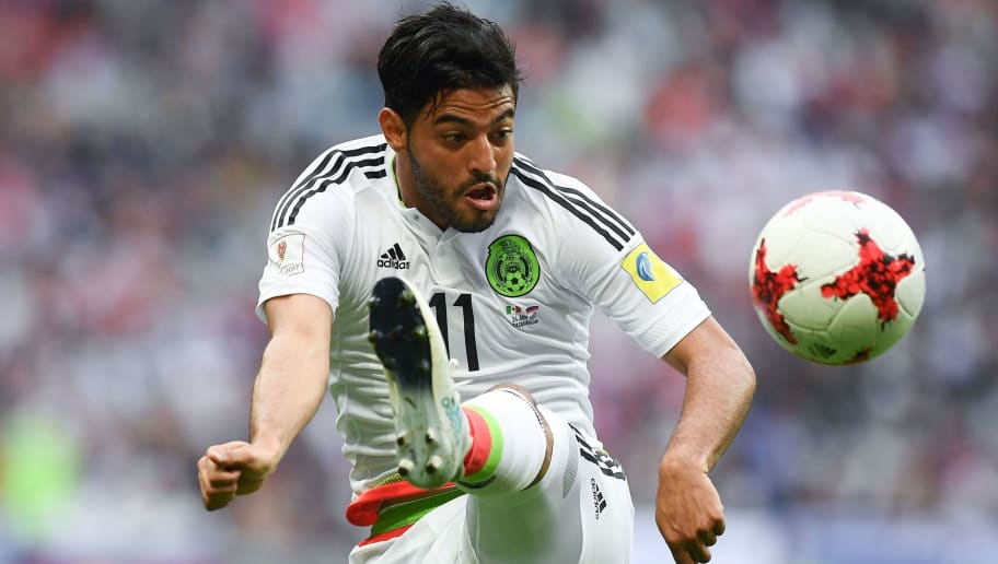 Mexico's midfielder Carlos Vela plays the ball during the 2017 Confederations Cup group A football match between Mexico and Russia at the Kazan Arena Stadium in Kazan on June 24, 2017. / AFP PHOTO / FRANCK FIFE        (Photo credit should read FRANCK FIFE/AFP/Getty Images)