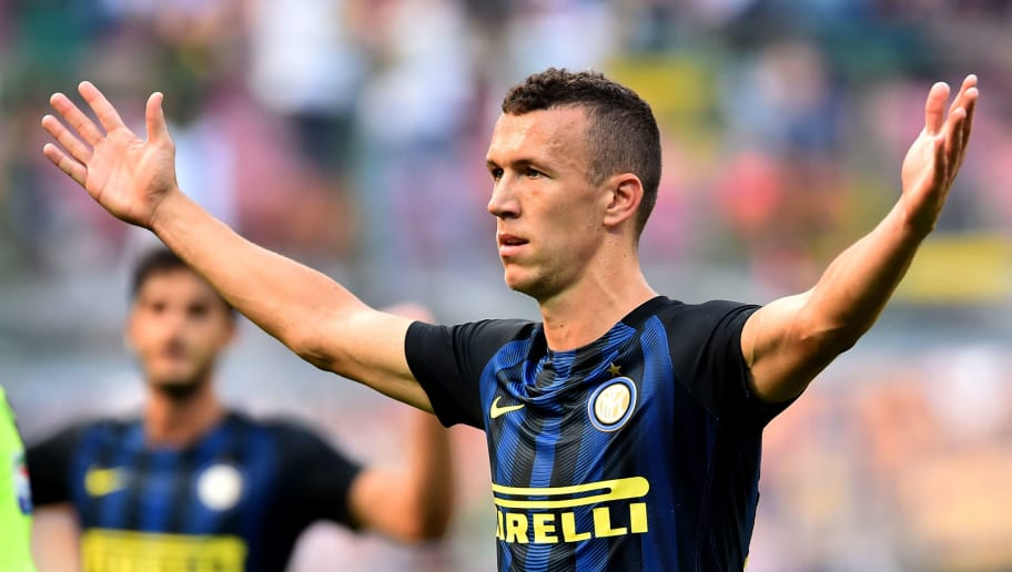 Inter Milan's Croatioan forward Ivan Perisic celebrates after scoring a goal during the Italian Serie A football match Inter Milan vs Bologna at the San Siro stadium in Milan on September 25,  2016.  / AFP / GIUSEPPE CACACE        (Photo credit should read GIUSEPPE CACACE/AFP/Getty Images)