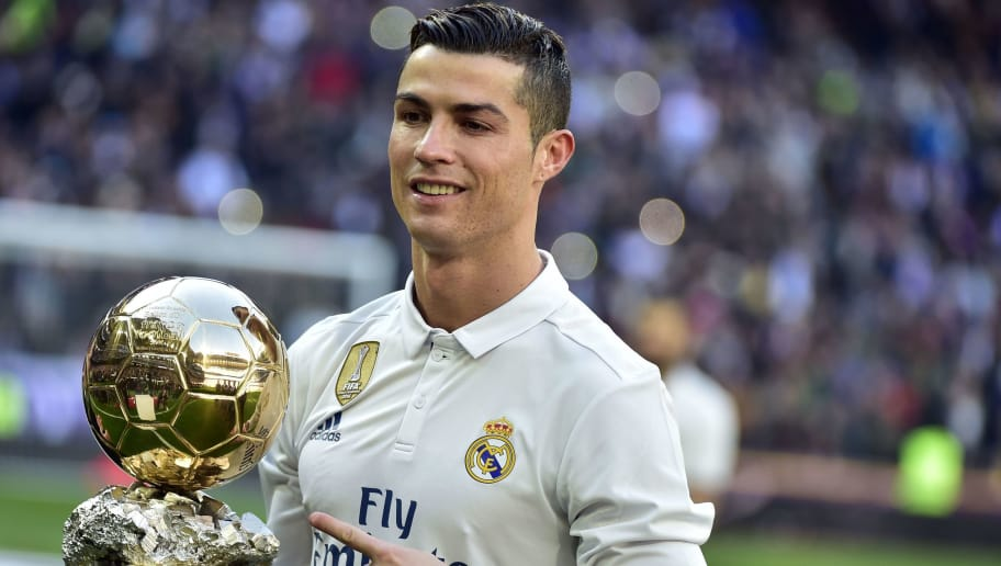 Real Madrid's Portuguese forward Cristiano Ronaldo poses with the Ballon d'Or France Football trophy before the Spanish league football match Real Madrid CF vs Granada FC at the Santiago Bernabeu stadium in Madrid on January 7, 2017. / AFP / GERARD JULIEN        (Photo credit should read GERARD JULIEN/AFP/Getty Images)