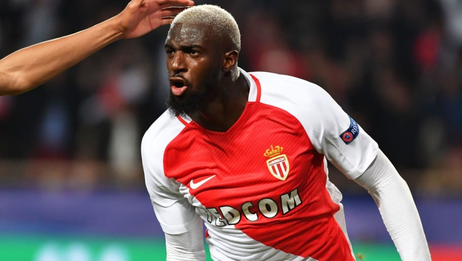 Monaco's French midfielder Tiemoue Bakayoko celebrates with Monaco's French forward Kylian Mbappe Lottin (back) after scoring a goal during the UEFA Champions League round of 16 football match between Monaco and Manchester City at the Stade Louis II in Monaco on March 15, 2017. / AFP PHOTO / PASCAL GUYOT        (Photo credit should read PASCAL GUYOT/AFP/Getty Images)