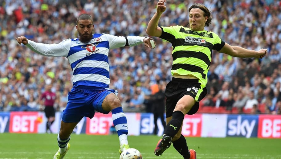 TOPSHOT - Reading's English striker Lewis Grabban (L) vies with Huddersfield Town's German defender Michael Hefele (R) during the English Championship play-off final football match between Huddersfield Town and Reading at Wembley Stadium in London on May 29, 2017. / AFP PHOTO / Glyn KIRK / NOT FOR MARKETING OR ADVERTISING USE / RESTRICTED TO EDITORIAL USE        (Photo credit should read GLYN KIRK/AFP/Getty Images)