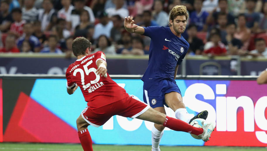 SINGAPORE - JULY 25: Thomas Mueller (L)  of Bayern Muenchen battles for the ball with Marcos Alonso of Chelsea during the International Champions Cup 2017 match between Bayern Muenchen and Chelsea FC at National Stadium on July 25, 2017 in Singapore, Singapore.  (Photo by Alexander Hassenstein/Bongarts/Getty Images)