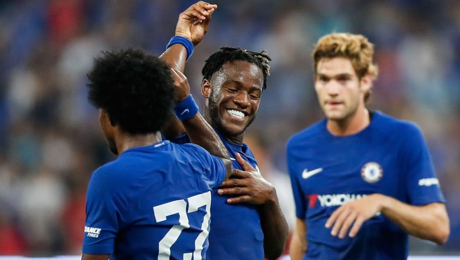 BEIJING, CHINA - JULY 22: Michy Batshuayi celebrates with Willian of Chelsea after scoring the second goal during the Pre-Season Friendly match between Arsenal FC and Chelsea FC at Birds Nest on July 22, 2017 in Beijing, China.  (Photo by Yifan Ding/Getty Images )