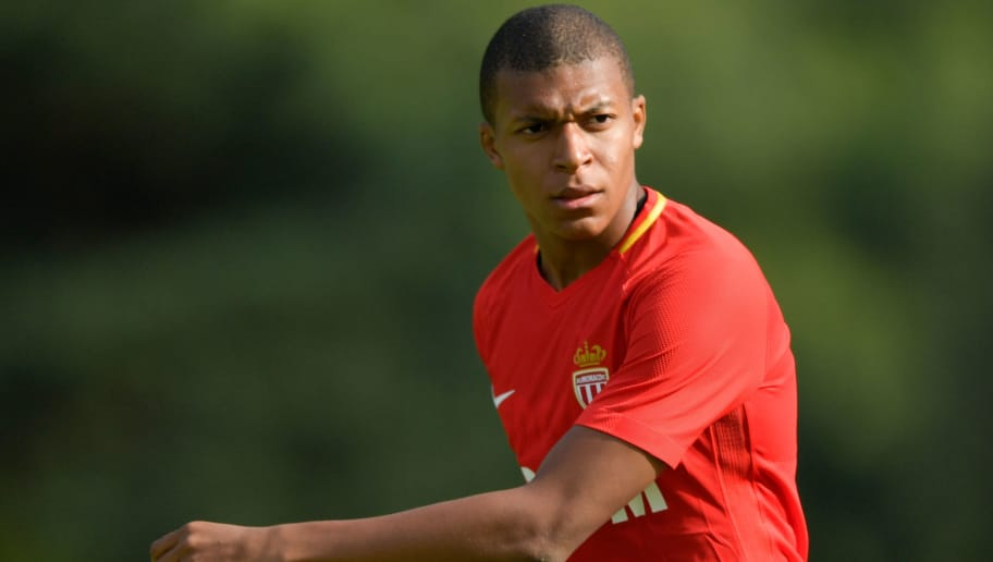 Monaco's forward Kylian Mbappe looks on during a friendly football match between AS Monaco and Stoke City FC in Martigny on July 15, 2017. / AFP PHOTO / Fabrice COFFRINI        (Photo credit should read FABRICE COFFRINI/AFP/Getty Images)