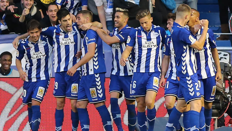 Deportivo Alaves players celebrate a goal during the Spanish league football match Deportivo Alaves vs Real Sociedad at the Mendizorroza stadium in Vitoria on March 18, 2017. / AFP PHOTO / CESAR MANSO        (Photo credit should read CESAR MANSO/AFP/Getty Images)