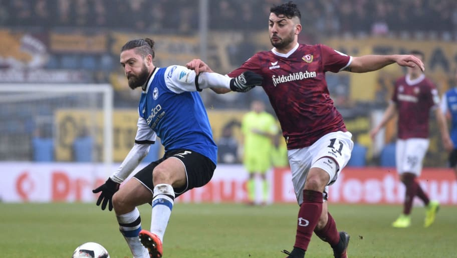 BIELEFELD, GERMANY - DECEMBER 18: David Ulm (L) of Bielefeld and Aias Aosman of Dresden fight for the ball during the Second Bundesliga match between DSC Arminia Bielefeld and SG Dynamo Dresden at Schueco Arena on December 18, 2016 in Bielefeld, Germany.  (Photo by Thomas Starke/Bongarts/Getty Images)
