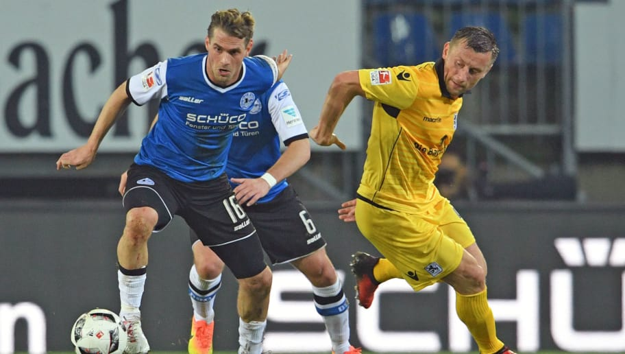 BIELEFELD, GERMANY - FEBRUARY 03: Soeren Brandy (L) of Bielefeld and Ivica Olic of Munich fight for the ball during the Second Bundesliga match between DSC Arminia Bielefeld and TSV 1860 Muenchen at Schueco Arena on February 3, 2017 in Bielefeld, Germany.  (Photo by Thomas Starke/Bongarts/Getty Images)