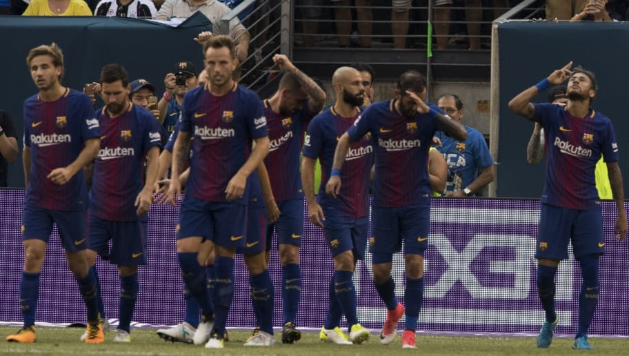 Neymar (R) of FC Barcelona reacts after his first goal during the International Champions Cup (ICC) match between Juventus FC and FC Barcelona, at the Met Life Stadium in East Rutherford, New Jersey, on July 22, 2017. / AFP PHOTO / DON EMMERT        (Photo credit should read DON EMMERT/AFP/Getty Images)