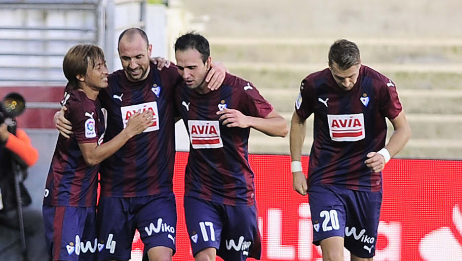 Eibar's defender Ivan Ramis (2nd L) celebrrates with teammates after scoring his team's first goal during the Spanish league football match between SD Eibar and Villarreal CF at the Ipurua stadium in Eibar on October 30, 2016. / AFP / ANDER GILLENEA        (Photo credit should read ANDER GILLENEA/AFP/Getty Images)