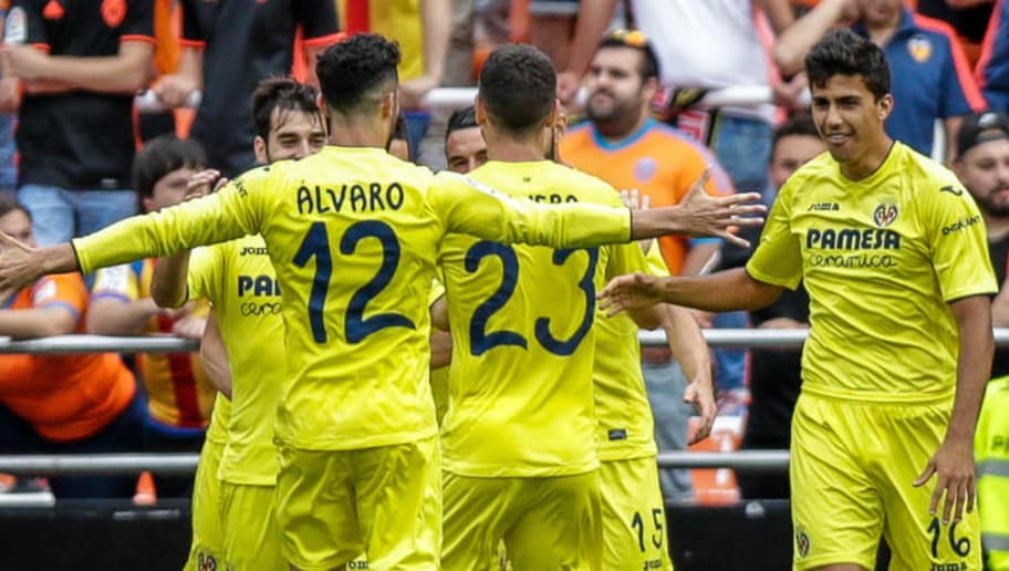 Villarreal's players celebrates after a goal during the Spanish League football match Valencia CF vs Villarreal CF at the Mestalla stadium in Valencia on May 21, 2017. / AFP PHOTO / BIEL ALINO        (Photo credit should read BIEL ALINO/AFP/Getty Images)