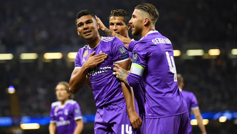 CARDIFF, WALES - JUNE 03:  Casemiro of Real Madrid celebrates scoring his sides second goal with his Real Madrid team mates during the UEFA Champions League Final between Juventus and Real Madrid at National Stadium of Wales on June 3, 2017 in Cardiff, Wales.  (Photo by Matthias Hangst/Getty Images)