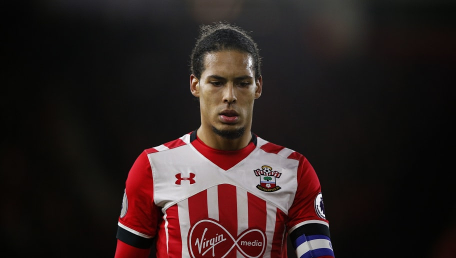Southampton's Dutch defender Virgil van Dijk reacts during the EFL (English Football League) Cup semi-final first-leg football match between Southampton and Liverpool at St Mary's Stadium in Southampton, southern England on January 11, 2017. / AFP / Adrian DENNIS / RESTRICTED TO EDITORIAL USE. No use with unauthorized audio, video, data, fixture lists, club/league logos or 'live' services. Online in-match use limited to 75 images, no video emulation. No use in betting, games or single club/league/player publications.  /         (Photo credit should read ADRIAN DENNIS/AFP/Getty Images)