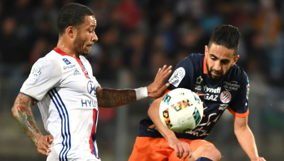 Lyon's Dutch forward Memphis Depay (L) vies with Montpellier's French midfielder Ryad Boudebouz (R) during the French L1 football match between Montpellier (MHSC) and Lyon (OL), on May 14, 2017 at the la Mosson Stadium in Montpellier, southern France. / AFP PHOTO / PASCAL GUYOT        (Photo credit should read PASCAL GUYOT/AFP/Getty Images)