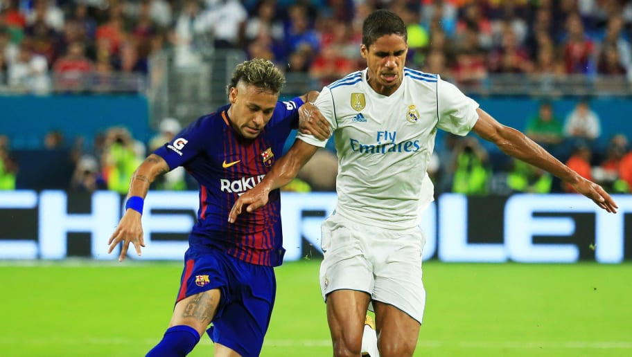 MIAMI GARDENS, FL - JULY 29:  Neymar #11 of Barcelona vies for the ball with Raphael Varane #5 of Real Madrid during their International Champions Cup 2017 match at Hard Rock Stadium on July 29, 2017 in Miami Gardens, Florida.  (Photo by Chris Trotman/Getty Images)