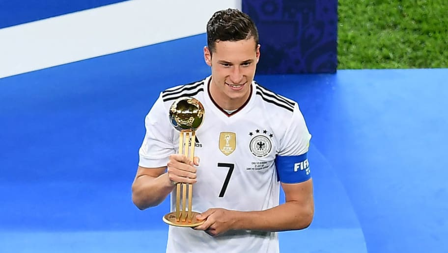 Germany's midfielder Julian Draxler holds the Golden Ball trophy after Germany beat Chile 1-0 in the 2017 Confederations Cup final football match between Chile and Germany at the Saint Petersburg Stadium in Saint Petersburg on July 2, 2017. / AFP PHOTO / YURI CORTEZ        (Photo credit should read YURI CORTEZ/AFP/Getty Images)