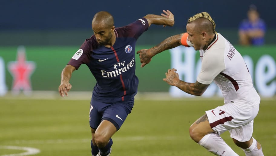 DETROIT, MI - JULY 19:  Lucas Moura #7 of Paris Saint-Germain tries to break away from Radja Nainggolan #4 of AS Roma during the second half at Comerica Park on July 19, 2017 in Detroit, Michigan. (Photo by Duane Burleson/Getty Images)