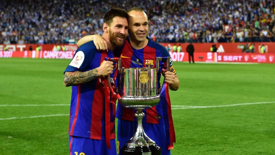 TOPSHOT - Barcelona's Argentinian forward Lionel Messi (L) and Barcelona's midfielder Andres Iniesta hold up the trophy after the team won the Spanish Copa del Rey (King's Cup) final football match FC Barcelona vs Deportivo Alaves at the Vicente Calderon stadium in Madrid on May 27, 2017. Barcelona won 3-1. / AFP PHOTO / Ander GILLENEA        (Photo credit should read ANDER GILLENEA/AFP/Getty Images)