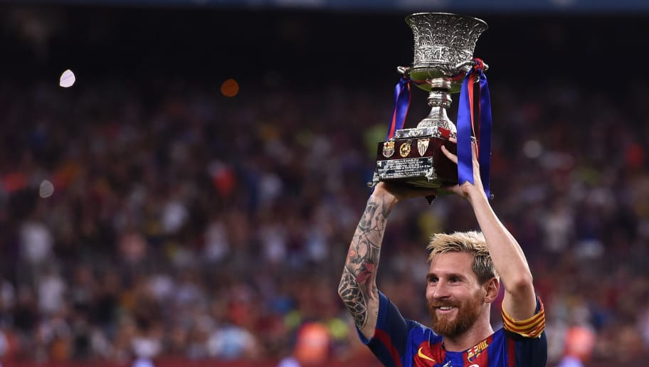Barcelona's Argentinian forward Lionel Messi holds the Spanish Supercup trophy after winning  after winning the second leg of the Spanish Supercup football match between FC Barcelona and Sevilla FC at the Camp Nou stadium in Barcelona on August 17, 2016. / AFP / JOSEP LAGO        (Photo credit should read JOSEP LAGO/AFP/Getty Images)