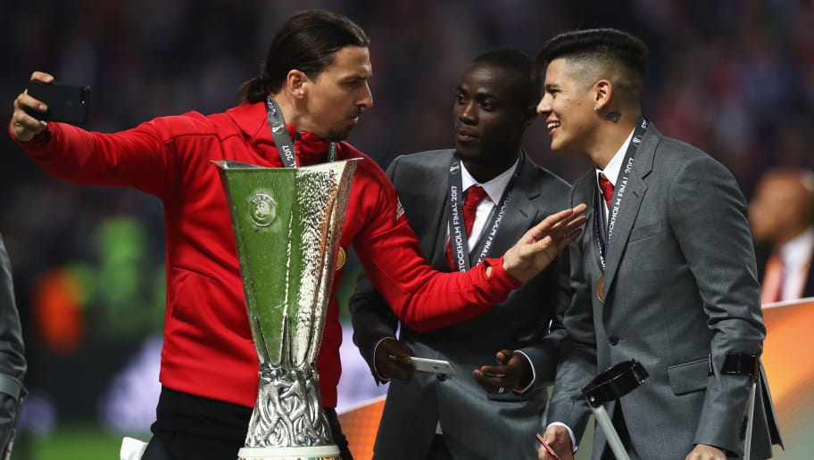 STOCKHOLM, SWEDEN - MAY 24:  Zlatan Ibrahimovic of Manchester United, Eric Bailly of Manchester United and Marcos Rojo of Manchester United take a selfie photograph with the trophy after the UEFA Europa League Final between Ajax and Manchester United at Friends Arena on May 24, 2017 in Stockholm, Sweden.  (Photo by Julian Finney/Getty Images)