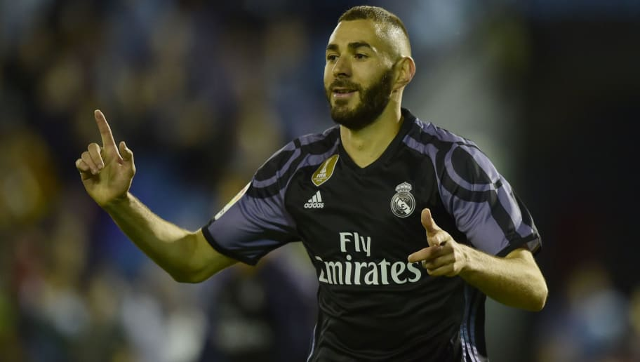 Real Madrid's French forward Karim Benzema celebrates after scoring their third goal during the Spanish league football match RC Celta de Vigo vs Real Madrid CF at the Balaidos stadium in Vigo on May 17, 2017. / AFP PHOTO / MIGUEL RIOPA        (Photo credit should read MIGUEL RIOPA/AFP/Getty Images)