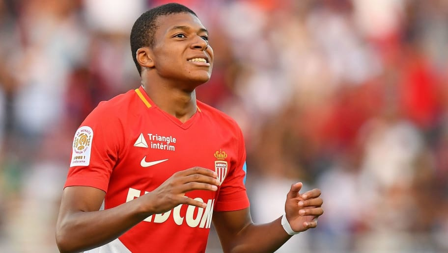 Monaco's French forward Kylian Mbappe reacts after missing a goal opportunity during  the French Trophy of Champions (Trophee des Champions) football match between Monaco (ASM) and Paris Saint-Germain (PSG) on July 29, 2017, at the Grand Stade in Tangiers. / AFP PHOTO / FRANCK FIFE        (Photo credit should read FRANCK FIFE/AFP/Getty Images)