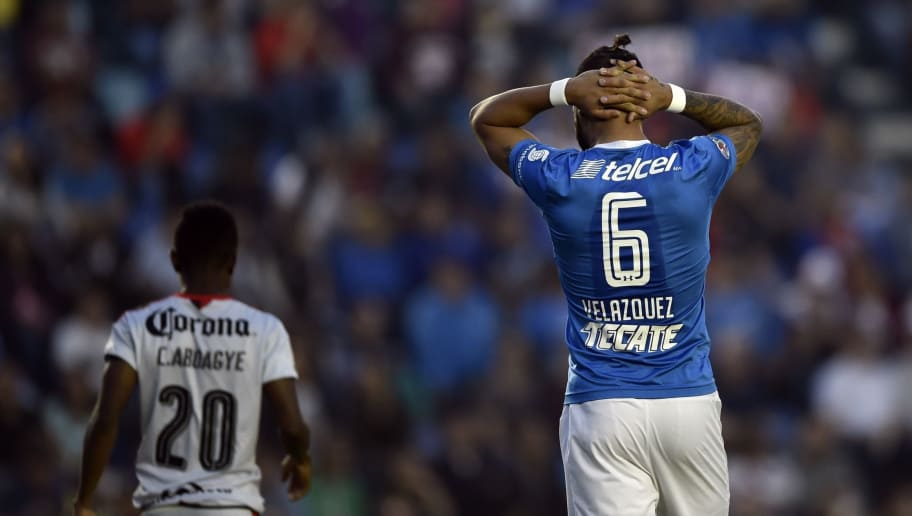 Cruz Azul's Julian Velazquez reacts during the Mexican Clausura tournament match against Atlas at the Azul stadium in Mexico City on February 18, 2017. / AFP / Pedro PARDO        (Photo credit should read PEDRO PARDO/AFP/Getty Images)